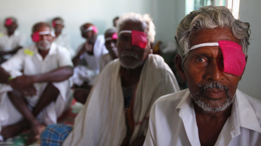 Patients sit with their eyes bandaged at an Aravind Eye Care clinic in Madurai, India after cataract surgeries. Aravind performs more than 300,000 cataract surgeries annually.