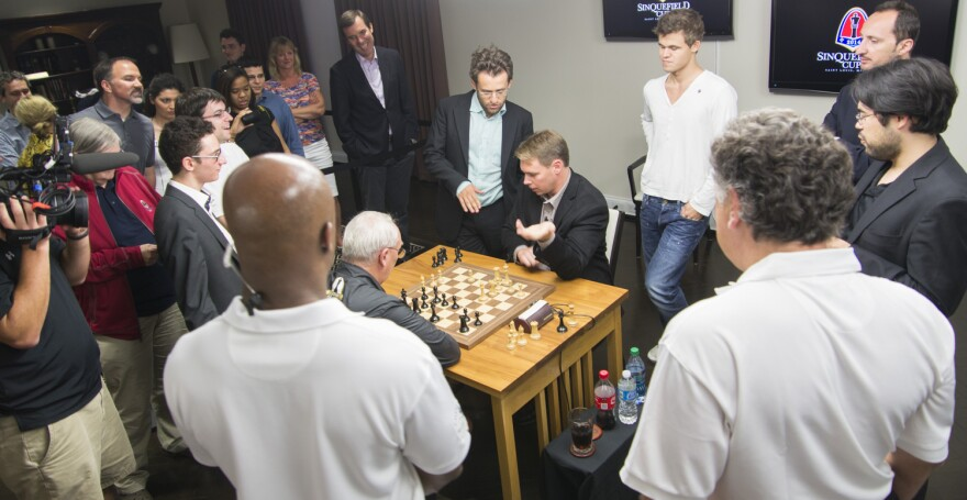 Legendary Grandmasters offer an overabundance of advice to amateur chess players Rex and Randy Sinquefield during Monday's Ultimate Moves exhibition.