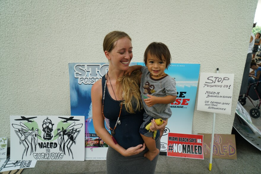 Alba Gosalbez and her son Oscar, pictured in front of anti-aerial spraying signs, were among attendees on Wednesday.
