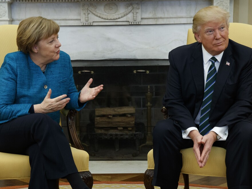 """President Donald Trump meets with German Chancellor Angela Merkel in the White House on Friday. """"It is much, much better to talk to one another and not about one another,"""" Merkel said."""