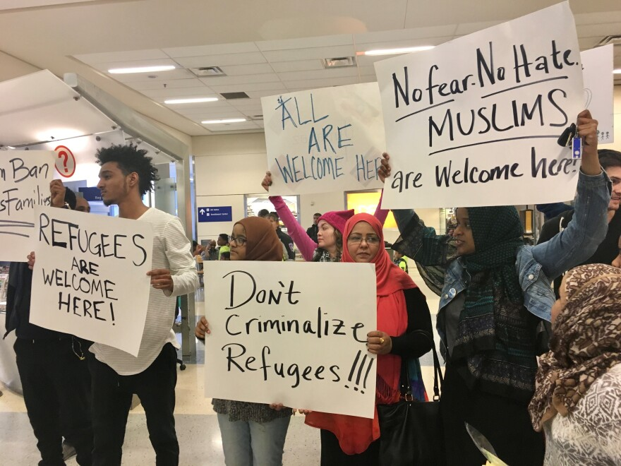 Hundreds of people protested Trump's so-called Muslim travel ban at Dallas/Fort Worth International Airport on January 28, 2017. Many stayed past midnight or returned the next day to protest.