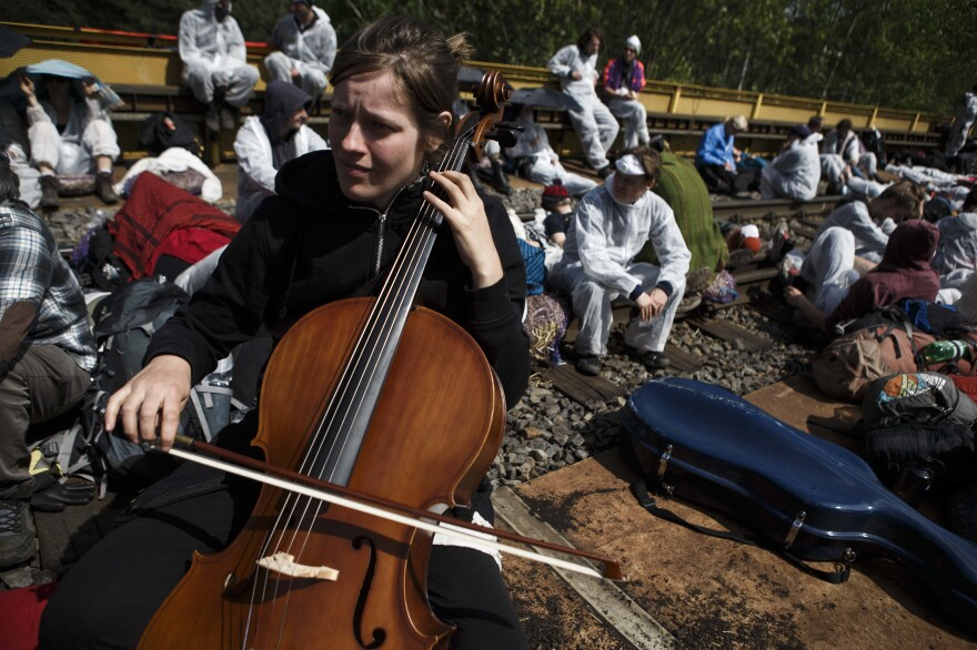 A cellist plays as anti-coal mine activists attempt a railway blockade near Spremberg, Germany, on Saturday.
