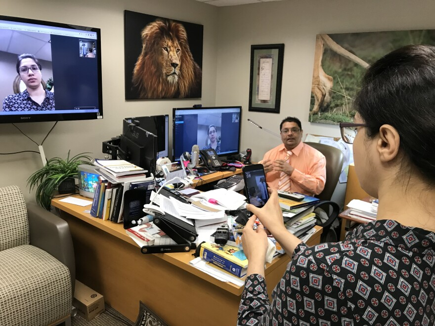 First-year Texas Tech internal medicine resident Fiza Fatima Menon simulates a telepsychiatry appointment with psychiatry Chair Dr. Bobby Jain, who is using telepsychiatry to treat children in Midland-area schools.