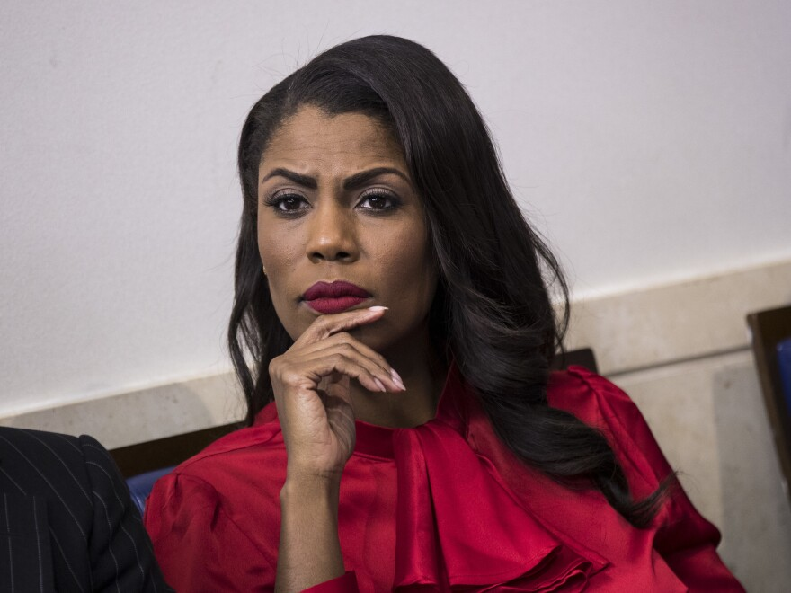 The Trump campaign says former aide Omarosa Manigault Newman violated an agreement she signed not to disparage Trump or disclose proprietary information.