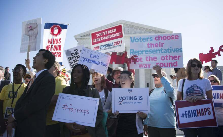 Demonstrators protest outside the Supreme Court in Washington, D.C., on Oct. 3 about partisan gerrymandering. Pew research finds Americans are split into multiple factions — beyond the two major parties.