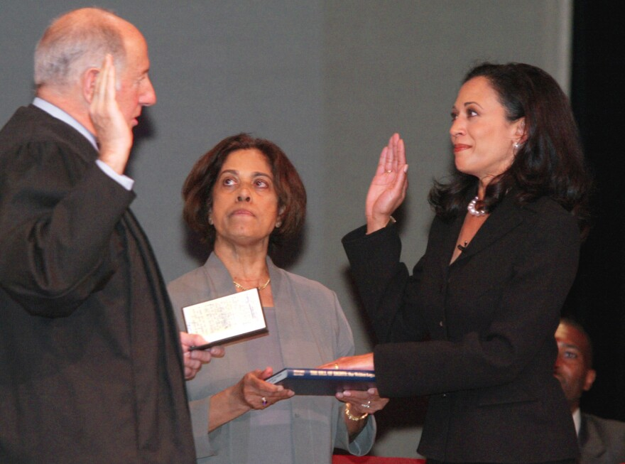 Kamala Harris receives the oath of office from California Supreme Court Chief Justice Ronald M. George during her inauguration on Jan. 8, 2004, as San Francisco's district attorney. In the center is Harris' mother, Shyamala Gopalan.