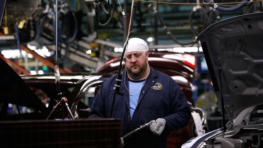"""A worker builds cars on the assembly line at Ford's Chicago Assembly plant, which has adopted the """"three crew"""" work schedule. The new third shift can increase efficiency in factories, but it can also wreak havoc on sleep needs and home lives."""