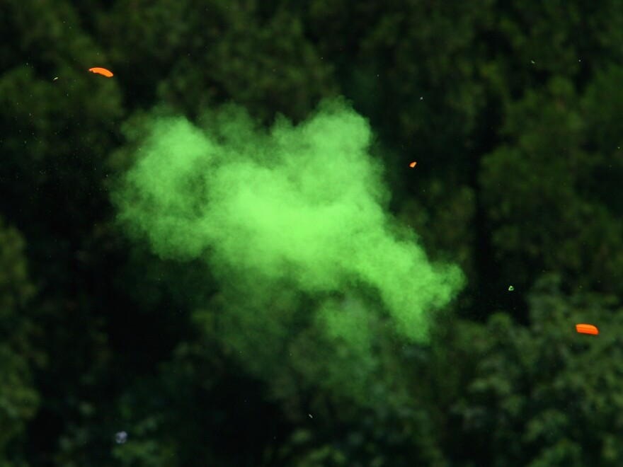 A clay target shatters during the 2008 Beijing Olympics.
