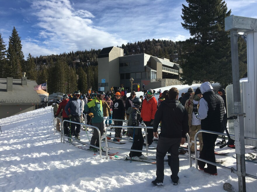 Photo of skiers waiting in line for the lift at Brighton.