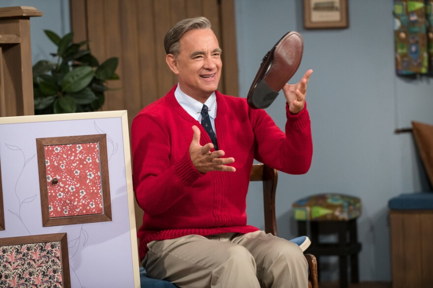 """Tom Hanks stars as Fred Rogers in <em>A Beautiful Day in the Neighborhood. </em>Hanks watched a lot of<em> Mister Rogers</em> to research the role and found as an adult, you don't really """"get it"""": """"Why is it taking so long? What's the big deal? What are these fish?"""""""