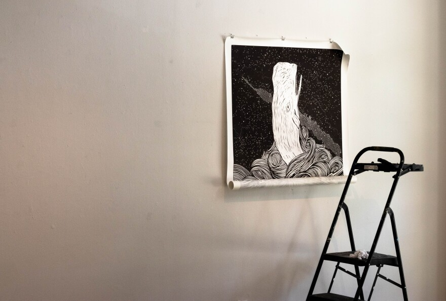 A finished print from the BIG INK woodblock printing press hangs mounted alone on the wall in preparation for the exhibit this weekend. Thomas Iacobucci/WUSF Public Media