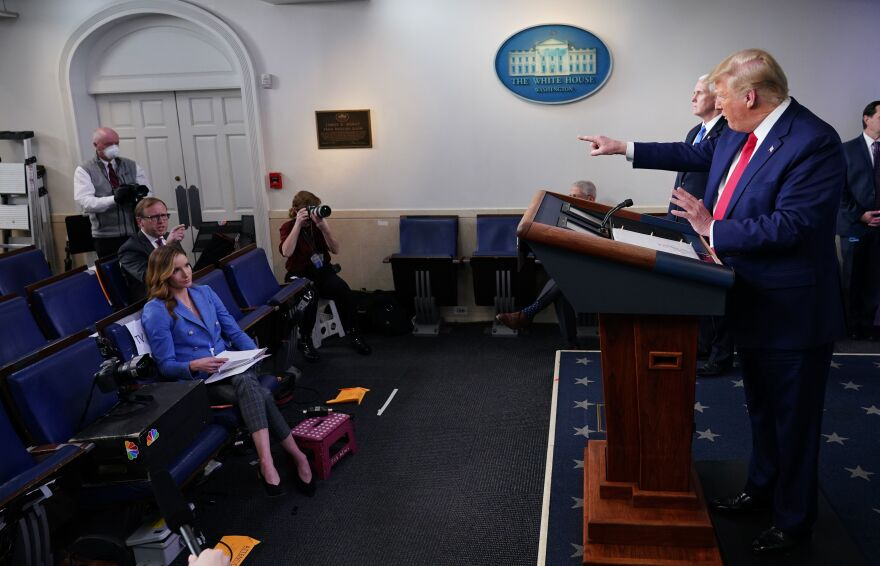 President Trump points to CNN journalist John Acosta during Monday's briefing with the White House coronavirus task force.