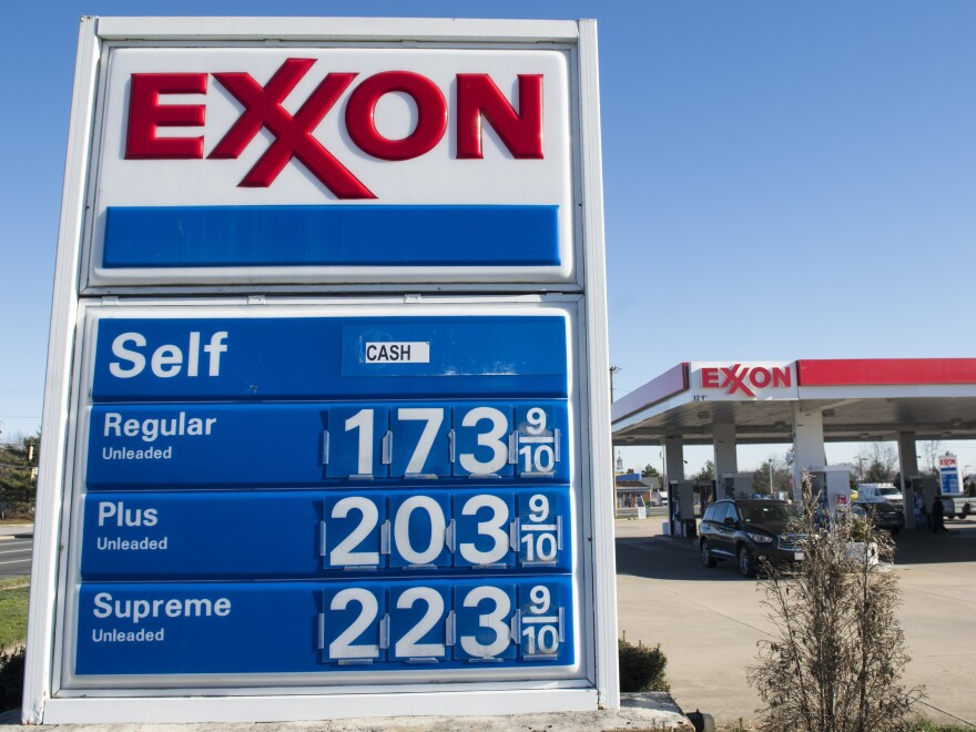 Prices, as seen at a gas station in Woodbridge, Va., on Tuesday, are 21 cents a gallon cheaper than this time last year. The drop violates the historic rule that tension such as that currently between key producers Saudi Arabia and Iran causes the cost of a barrel of oil to rise.