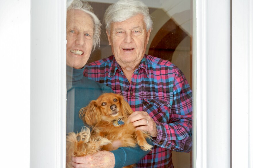 Dwight Cabot Camp, 84, with his wife, Kay, and their dog, Cabbie.
