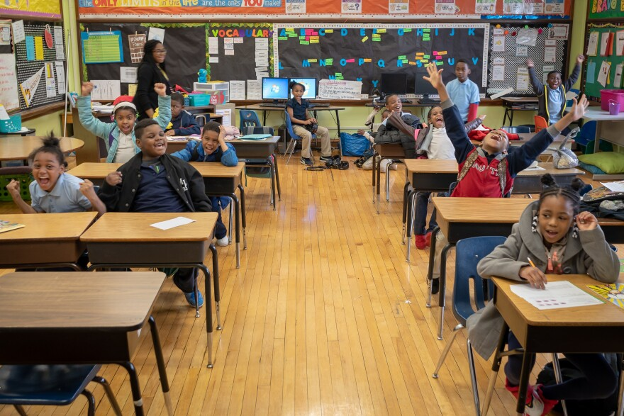 Second-graders at Bryan Hill Elementary School react to having their class announced over the intercom for having perfect attendance. The north St. Louis school has the second-best attendance in the district.