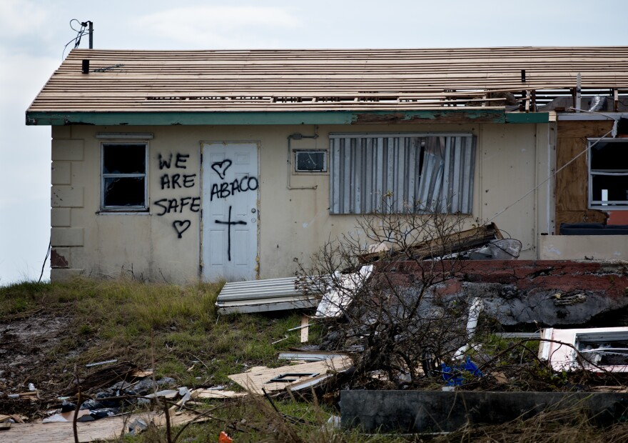 Residents of Marsh Harbour who survived Hurricane Dorian leave messages on their door to let loved ones and officials know they are OK.