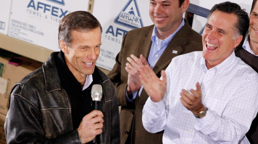 Mitt Romney gets a kick out of South Dakota Sen. John Thune's comments during a January rally in Dubuque, Iowa.