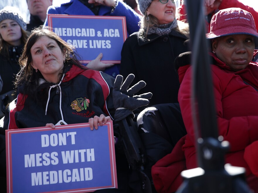 "Health care activists rallied in front of the U.S. Capitol on March 22, 2017, to protest Republican efforts that would have dismantled the Affordable Care Act and capped federal payments for Medicaid patients. The Republican congressional bills, part of the party's ""repeal and replace"" push in 2017, were eventually defeated."