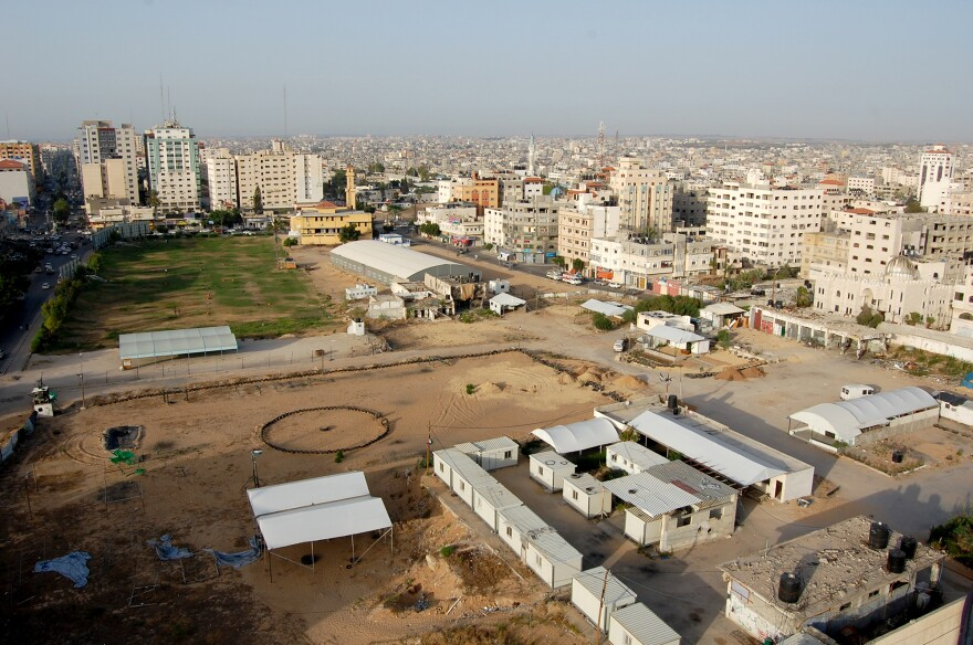 The view from Level Up includes a a former prison — in front of the long, low building with the curved roof — and, in the foreground, a Hamas police training ground.