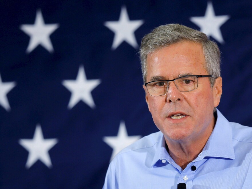"""Exploratory"" Republican presidential candidate Jeb Bush speaks April 17 at the First in the Nation Republican Leadership Conference in Nashua, N.H. His super PAC — Right to Rise — is aiming to raise $100 million dollars by June 1."