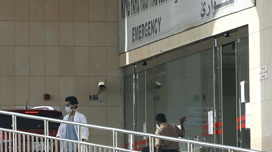 A medical worker stands outside the emergency room of King Fahd Hospital, in Jeddah, Saudi Arabia, April 9. Authorities closed the ER department after two health workers at the hospital caught the Middle East Respiratory Syndrome.