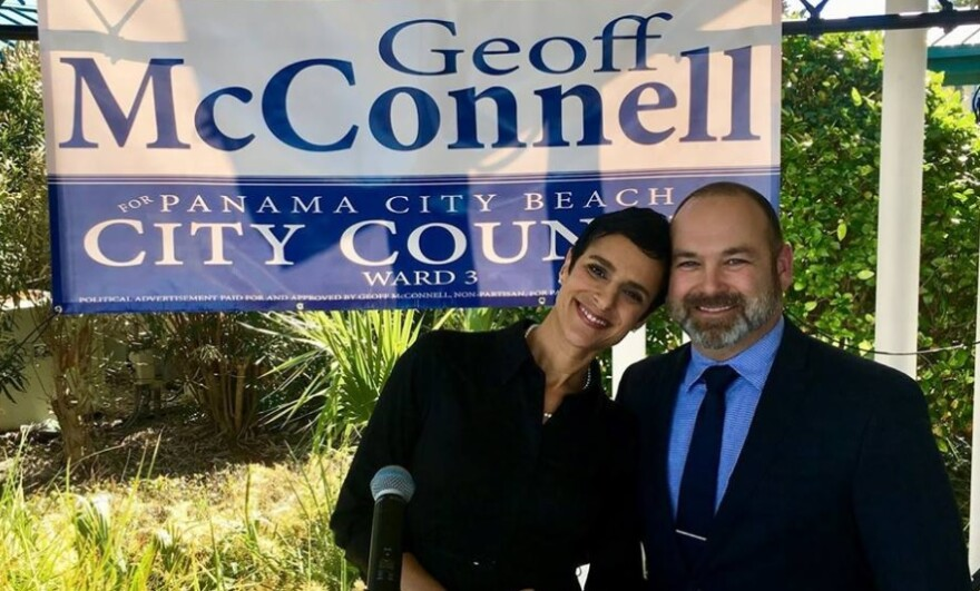 In front of a campaign sign, Geoff McConnell is with his wife