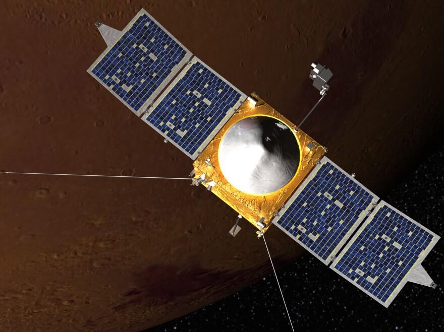 An artist's rendering of the U.S. MAVEN spacecraft in orbit around Mars.
