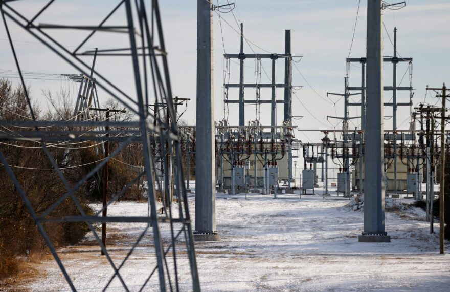 Transmission towers and power lines lead to a substation after a snow storm in Fort Worth, Texas.