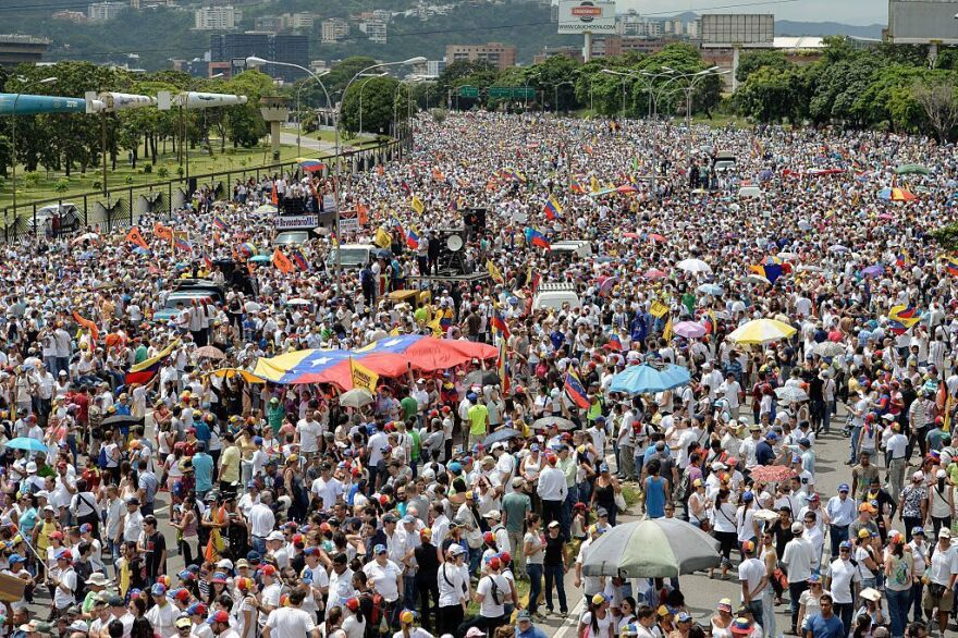 Opponents of Maduro rallied in the streets as the leftist leader convened a crisis security meeting resisting their efforts to drive him from power.