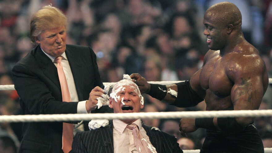 WWE chairman Vince McMahon (C) has his head shaved by Donald Trump (L) and Bobby Lashley (R) after losing a bet in the Battle of the Billionaires at the 2007 World Wrestling Entertainment's Wrestlemania in Detroit, Michigan.