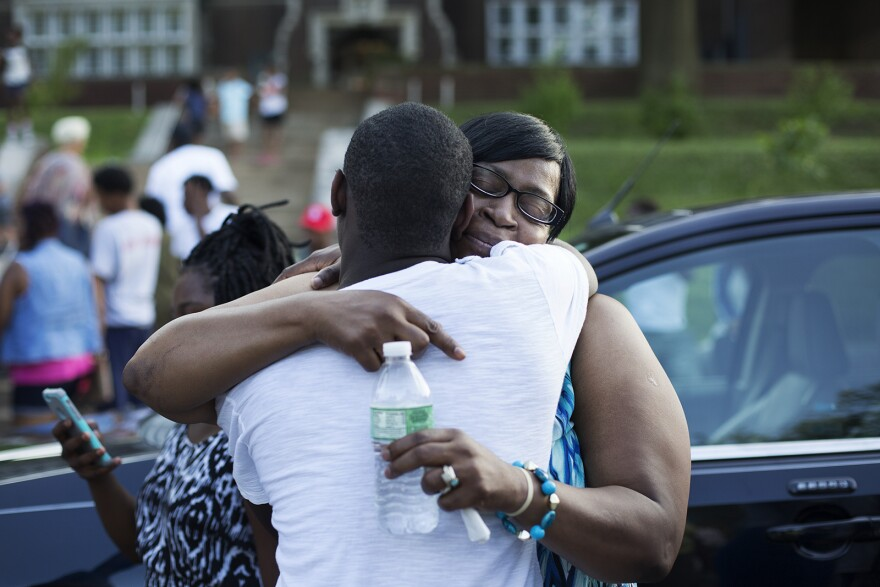 Jacara Sproaps' mother, Janice Sproaps, receives a hug.