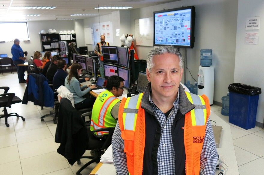 """Kevin Smith, CEO of SolarReserve, stands in the control room of the Crescent Dunes Solar Energy Plant. """"This is really the first utility-size project of this type in the world,"""" he says."""