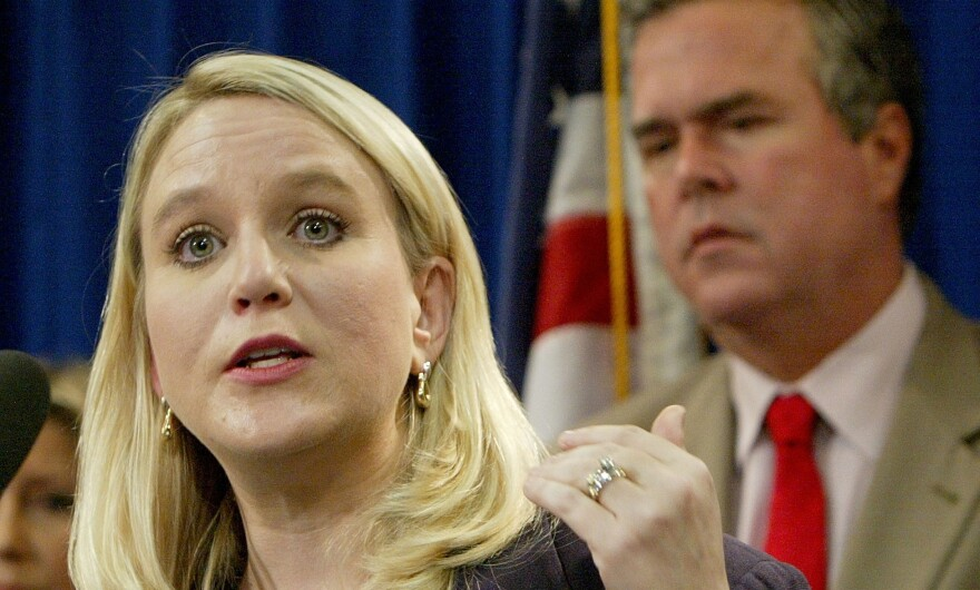 Tiffany Carr, then executive director of the Florida Coalition Against Domestic Violence, speaks at a news conference held by Gov. Jeb Bush on Tuesday, Sept. 28, 2004, in Tallahassee, Fla.