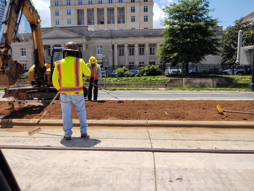 Gold Line track has been installed in the roadway along West Trade Street uptown.