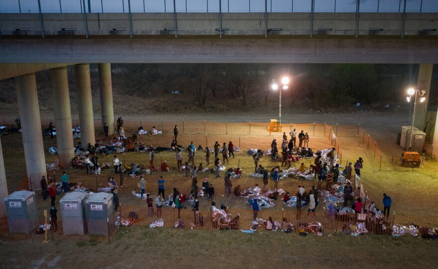 Asylum seeking migrant families and unaccompanied minors take refuge in a makeshift U. S. Custom and Border Protection processing center under Anzalduas International Bridge after crossing the Rio Grande into the United States from Mexico in Granjeno, Texas, U.S., March 12, 2021. Photo by Adrees Latif/Reuters