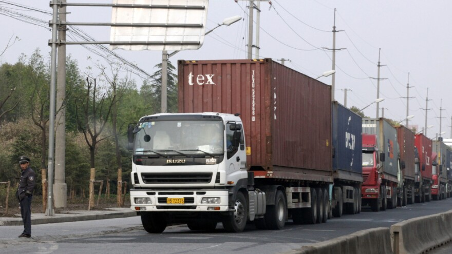 Trucks left parked on a road near a Shanghai port Friday. Truck drivers protested for a third day over rising fuel costs and fees, disrupting the flow of goods.