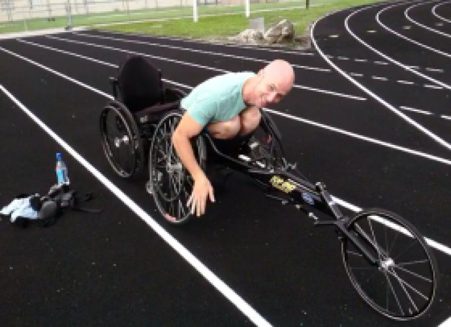 Dwayne_in_racing_chair.png