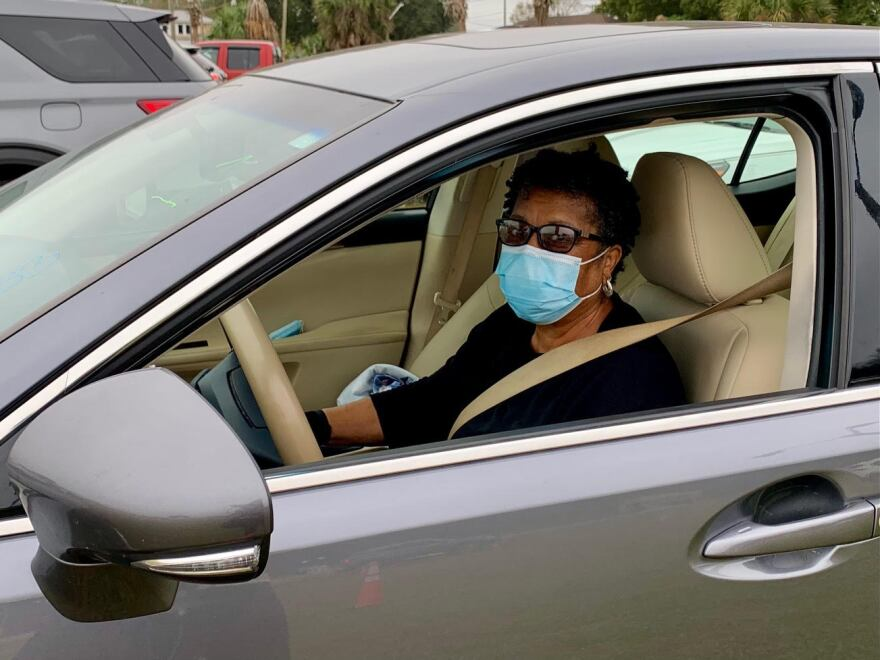 Hillsborough County resident Lelia Clark sits in her car at a coronavirus vaccination site.