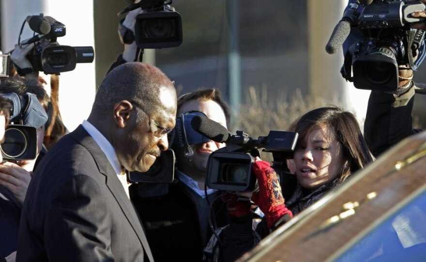 Herman Cain leaving the New Hampshire Union Leader newspaper after meeting with its editorial board, Thursday, Dec. 1, 2011.