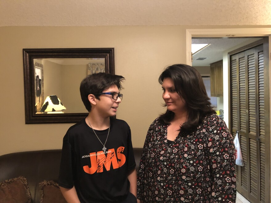 Wes Scalf, 13, speaks to his mom, Lisa Scalf, in their home in February 2019.