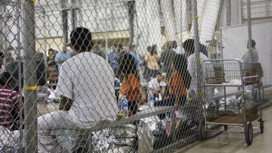 A photo provided by U.S. Customs and Border Protection shows people detained at a facility in McAllen, Texas, on Sunday.