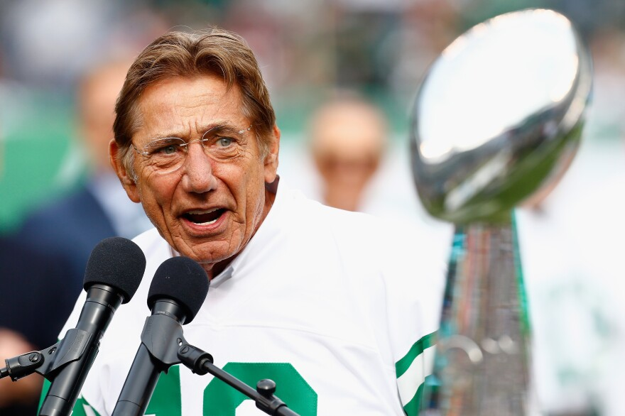 Joe Namath speaks during halftime of a New York Jets game in 2018. As quarterback, he led the Jets to a Super Bowl win in 1969.