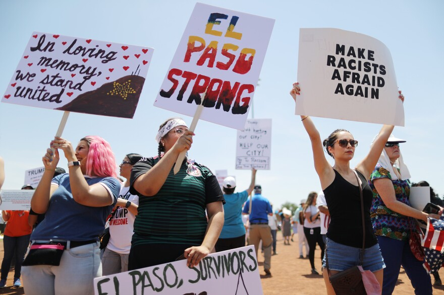Demonstrators stand at a protest against President Trump's visit following a mass shooting, which left at least 22 people dead, on August 7, 2019 in El Paso, Texas. Protestors also called for gun control and denounced white supremacy. (Mario Tama/Getty Images)