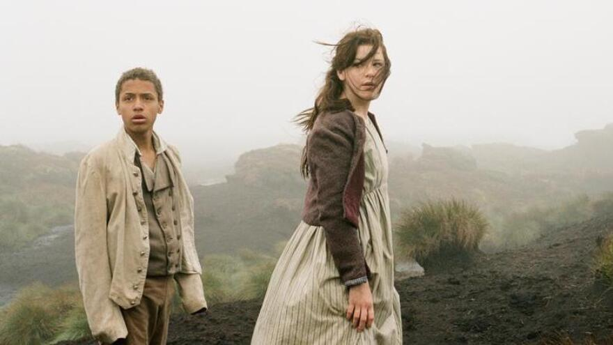 Young Heathcliff (Solomon Glave) and Young Catherine (Shannon Beer) grow up to be an iconic, romantically doomed couple in <em>Wuthering Heights</em>.