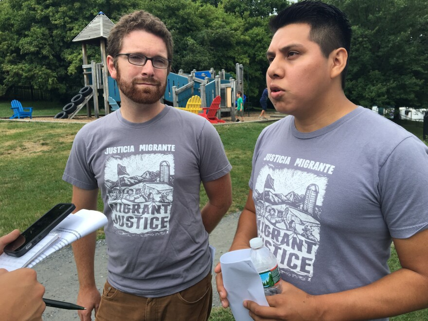 Will Lambek, left, interprets for Enrique Balcazar, a Migrant Justice activist who helped negotiate the fair labor and living standards agreement with Ben & Jerry's.
