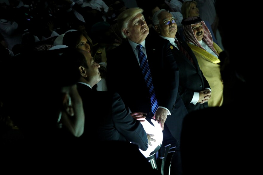 Together with Egyptian President Abdel-Fattah el-Sissi and Saudi King Salman bin Abdul-Aziz Al Saud, President Trump touches a lit-up globe that activated a video at the inauguration of the Global Center for Combating Extremist Ideology in Riyadh, Saudi Arabia.