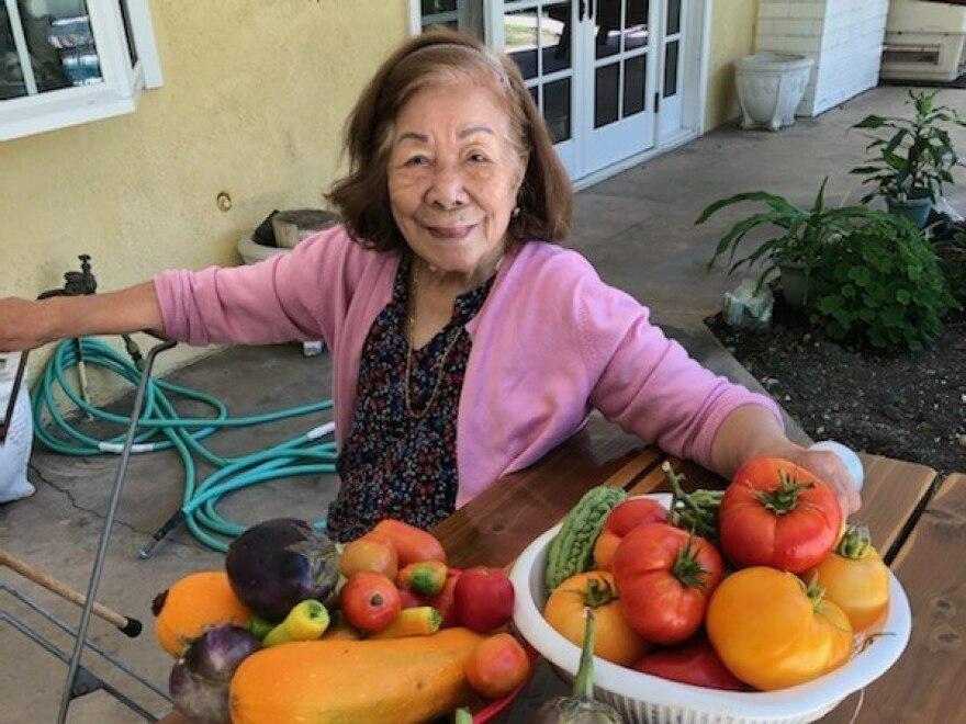 The author's grandmother, Felisa Mercene, 92, with the summer harvest from her son's garden in La Mirada, Calif.