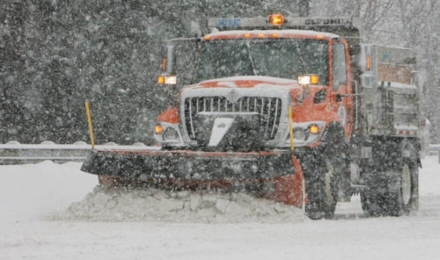 An Akron snow plow in the midst of a snow storm.