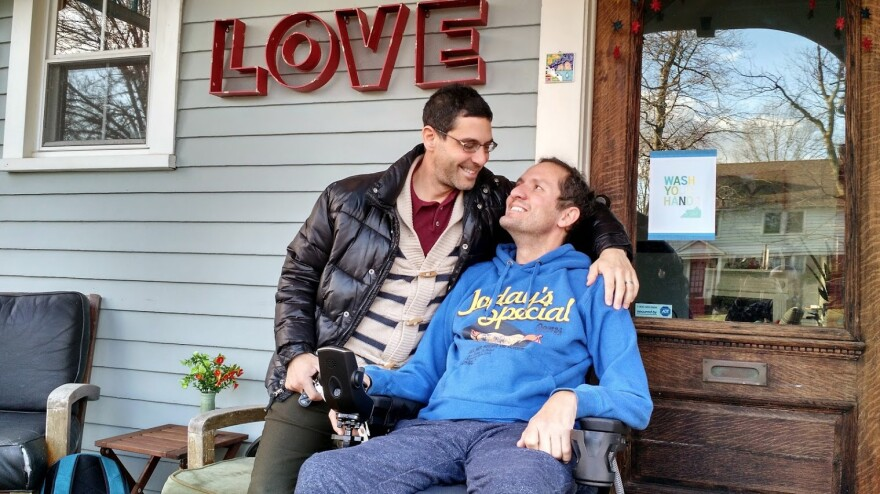 Dave Adox, right, and his husband Danni Michaeli at their home in South Orange, N.J., in the fall of 2014. Adox was diagnosed with ALS at age 42 and became almost totally paralyzed within six months. He died last May.