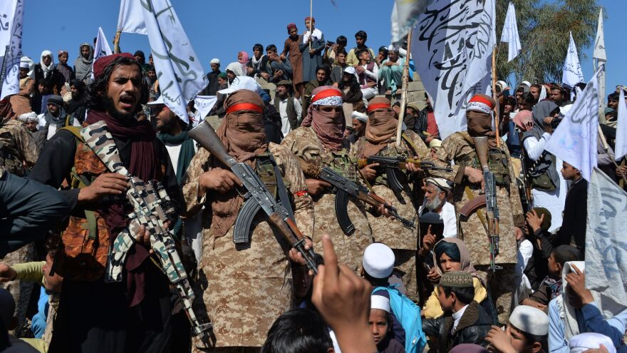 Militants linked with the Afghan Taliban gather Monday for a ceremony in Laghman province, celebrating the agreement the group signed with the U.S. over the weekend.